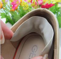 Il rilievo di cuoio della parte posteriore dei pattini dell'alto tallone della fodera del sottopiede della protezione del cuscino del cuscinetto di cura del piede libera il trasporto 2000pcs / lot 1000pairs