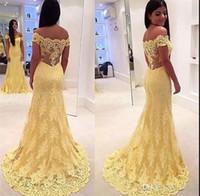 Fuera del hombro Sirena de encaje amarillo Vestidos de noche formales 2017 Sweep Train Tulle fruncido Sin espalda Ilusión Volver Vestidos de fiesta de baile
