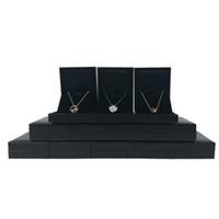 12 Unids Cajas de Exhibición de La Joyería de Cuero Negro Compromiso de Boda Colgante Collar Pendiente Organizador Caja de Regalo de Almacenamiento 8 * 6.5 * 2.7 cm