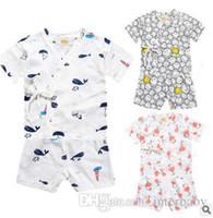 Ins Niños Pijamas Baby Summer Nightsuits T-shirt Pantalones Camisetas de manga corta Pantalones cortos Niños Ropa de dormir de dibujos animados Pantalones de dormir Moda Payamas K59