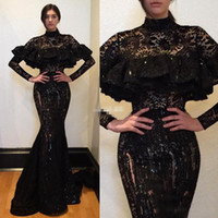 Arabie Saoudite Robes de bal en dentelle noire 2017 manches longues manches longues Robes de soirée sirène Sexy Voir à travers les femmes