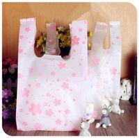 Gros- taille Livraison gratuite 18 * 35cm (7 « * 14 ») Supermarché shopping sac en plastique avec poignée impression sac en plastique fleur de cerisier 100pcs / lot