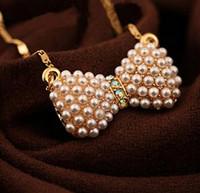 Explosivas jóias de moda pequeno fresco arco colar de pérolas doce arco pérola pingente de cristal atacado frete grátis