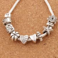 Bel design cuore grande foro perline distanziali 140pcs / lot argento tibetano fit fascino braccialetto gioielli fai da te metalli allentati perline lm37