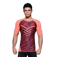프로 스포츠 피트니스 브라이언 꽉 바지 트레이닝 빠른 드라이 T 셔츠 드레스 의류를 실행 남성 반소매 체력을