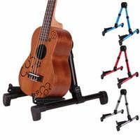 alta qualità portatile universale pieghevole stand per chitarra acustica a-cornice strumenti di supporto per ukulele / banjo / violino / mandolino