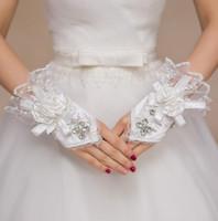 Neue Braut Perlen Handschuhe für Brautkleid Brautkleid Freie Größe Handschuhe Verband Fingerlose Hohle Spitze Handgelenk Länge
