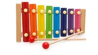 O envio gratuito de mão octave batida música de piano educacional infantil infantil Tong Yizhi música bebê meninos e meninas brinquedos mão de madeira bater k
