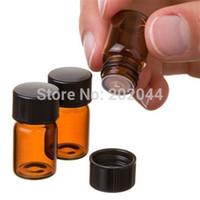 Großhandelsqualität 50 Satz 1 ml (1/4 Dram) Flasche des bernsteinfarbigen Glasätherischen Öls, Öffnungs-Reduziererkappe Fabrik-Preis