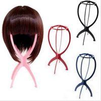 Sostenedor de la exhibición de la peluca la herramienta del soporte portátil estable plegable de plástico durable del casquillo de la peluca de pelo del sombrero sostenedor del soporte de exhibición de la herramienta soporte de la peluca