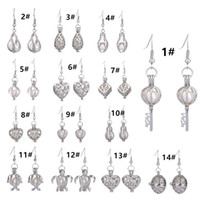 Earring with 18KGP Cage Lockets and Nature Fresh water pearl...