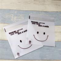 Bolsas De Regalo 300pcs / lot-14x16.5cm / 11x13.5cm Givré Smile Visage Sac Biscuit Bonbons Auto-adhésif Diy Paquet Paquet Emballage Alimentaire Sacs