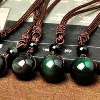 Natural Negro obsidiana arco iris del ojo grano de la bola redonda de suerte colgante de cristal del amor de Energía joyería con la cuerda libre para mujeres y hombres