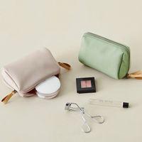 한국은 방수가 간단하고 가방을 만들기 위해 스테레오 트럼펫 메이크업 가방 여행을 손에 들고 있습니다.