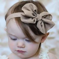 Venta al por mayor- 1pc 14 colores 2016 Moda de alta calidad de alta calidad Bowknot Baby Headbands Color sólido Bebé niña Elástica de las bandas del pelo de la gota Envío