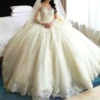 로맨틱 한 두바이 아랍어 웨딩 드레스 깎아 지른 보석 목 레이스 Applique 긴 소매 브라 가운 2017 매력적인 대성당 기차 웨딩 드레스