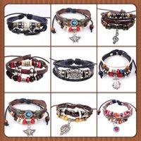 Nuevos diseños pulsera de cuero antiguo cruz ancla amor melocotón corazón búho pájaro creer perla tejer bronce encanto pulseras