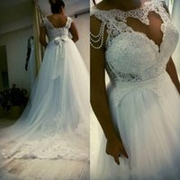8 Photos Wholesale Bridal Dresses China
