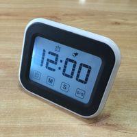 Les fabricants vendant de nouveaux rappels d'apprentissage de la minuterie électronique de cuisine pour toucher la minuterie