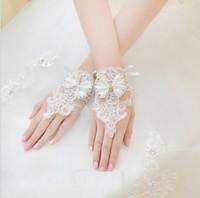 Trasporto libero, 2019 nuovo bianco / avorio pizzo applique bowknot brevi guanti da sposa per la vendita intera di nozze dalla cina a buon mercato