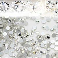 1440pcs / lot nagelkonst glitter rhinestones vit kristallklar flatback diy tips klistermärke pärlor nagel smycken tillbehör