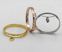 NUOVO bracciale rigido in oro rosa titanio con numeri romani cuore pesca in oro rosa