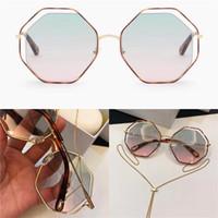 Nueva moda Gafas de sol populares Marco irregular con diseño de lentes de diseño especial con colgantes Mujer extraíble Tipo favorito Calidad superior 132