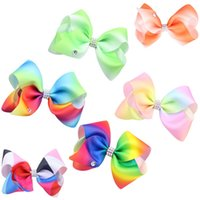 The rainbow color gradient rib of a child' s bow hairpin...