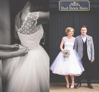 Vestidos de novia cortos de lunares del estilo de la vendimia de los años 1950 Vestidos de novia Vestidos de novia de la playa Vestidos de novia de la longitud del té