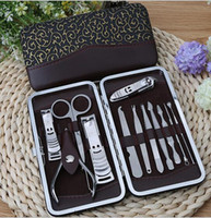 Livraison DHL 12 en 1 set Soins des ongles Set Pédicure Ciseaux Tweezer Couteau Oreille pick Utilitaire Manicure Outils Nail Clipper Kit