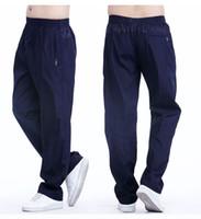 야외 스포츠 바지 남성 느슨한 조깅 캐주얼 바지 주머니와 패션 실행 긴 바지 남자 플러스 크기 XXXL