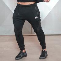 Новая золотая медаль Фитнес повседневные эластичные брюки из эластичного хлопка Мужские брюки Боди-инженеры Jogger Бодибилдинг Брюки