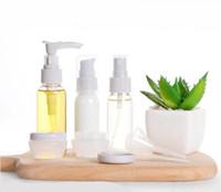 9 adet / paket Doldurulabilir Şişeler Seyahat Seti Yüz Kremi Losyon Kozmetik Dağıtım Konteyner Şampuan Saç Kremi Plastik Boş Kavanoz Pot