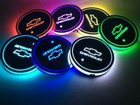 2pcs / 세트 분위기 chevy 컵 브랜드 매트 물 반짝 이는 시보레 자동차 빛 LED 패드 로고 그루브 빛나는 컵 받침 QNews