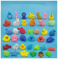 Hohe Qualität Baby Badewasser Ente Spielzeug Sounds Mini Gelb Gummienten Bad Kleine Ente Spielzeug Kinder Schwimmen Strand Für kinder Geschenke
