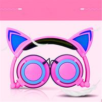 El más reciente de 3,5 mm de regalos Orejas de gato de dibujos animados Los niños montado en la cabeza de auriculares luminoso plegable del teléfono móvil Música HeadphoneWith paquete al por menor Auricular