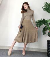 Sonbahar kış kadın turtleneck lurex tırmanmak uzun kollu örme kazak ve elastik bel pilili uzun etek 2 parça takım elbise twinset