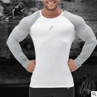 Printemps Marque Hommes T-shirt rapide Trois sec Quarter Sleeve T-shirt Casual Male Bodybuilding Slim T-shirts
