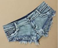Frauen neue europäische sexy Mode niedrigen Taille ultra kurzen Tanz Club Leistung Jeans Shorts Quaste Dreieck Shorts plus Größe SML