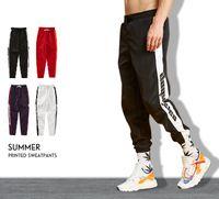 2018 Herbst Herren Sport Hosen Brief gedruckt Hip Hop Jogger Hosen beiläufige Kordelzug Bleistift Hosen 4 Farben Sportwear