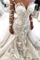 2019 Vestidos de novia glamorosa de la sirena con el tren desmontable Illusion Sheer Cuello Mangas largas Flores hechas a mano Vestidos de novia de lujo BA9786