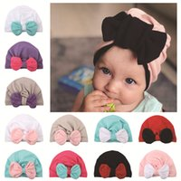 2018 New Baby fall winter hats Wholesale Contrast Bow beanie...
