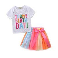 حلوة الطفل الفتيات تتسابق انها هدية عيد ميلادي الأطفال هدية بيضاء قمم تي شيرت + توتو السراويل تنورة مجموعة ملابس الفتاة