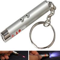 El mejor precio 700pcs montón Nueva 2 en 1 de luz blanca y roja lápiz puntero láser llavero linterna