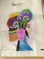 التجزئة الكلاسيكية فتاة كيس من البلاستيك 25x35 سنتيمتر، 100 قطعة / الوحدة التسوق مجوهرات تغليف الأكياس مع مقبض للملابس متجر مستحضرات التجميل