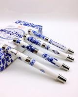 Vintage Dragon Naturel En Céramique Plume Stylo De Luxe calligraphie Haut de Gamme Chinois Bleu et Blanc Porcelaine D'affaires Cadeau Encre Stylo Boîte Reliée