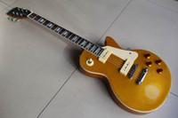 Wholesale 1956 Modèle guitare électrique .Gold top qualité sonore standard guitar.High instrument de musique Livraison gratuite