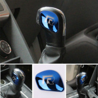 AEING Voiture Pommeau de levier de vitesses Couvercle de la tête de protection R Symbole Autocollants pour VW Volkswagen Golf 7 MK7 Golf 5 6 Passat B5