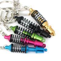 تعديل سيارة الجزء امتصاص الصدمات كيرينغ سبيكة سلسلة المفاتيح هدية مبيعات عالية