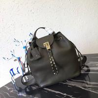 a452ea4c0b4a Luxury brand Women Backpack Genuine cow leather Fashion Golden Lock Rivets  designer handbag women travel leather backpacks street bag